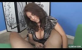 Sexy busty mom gives her son a handjob